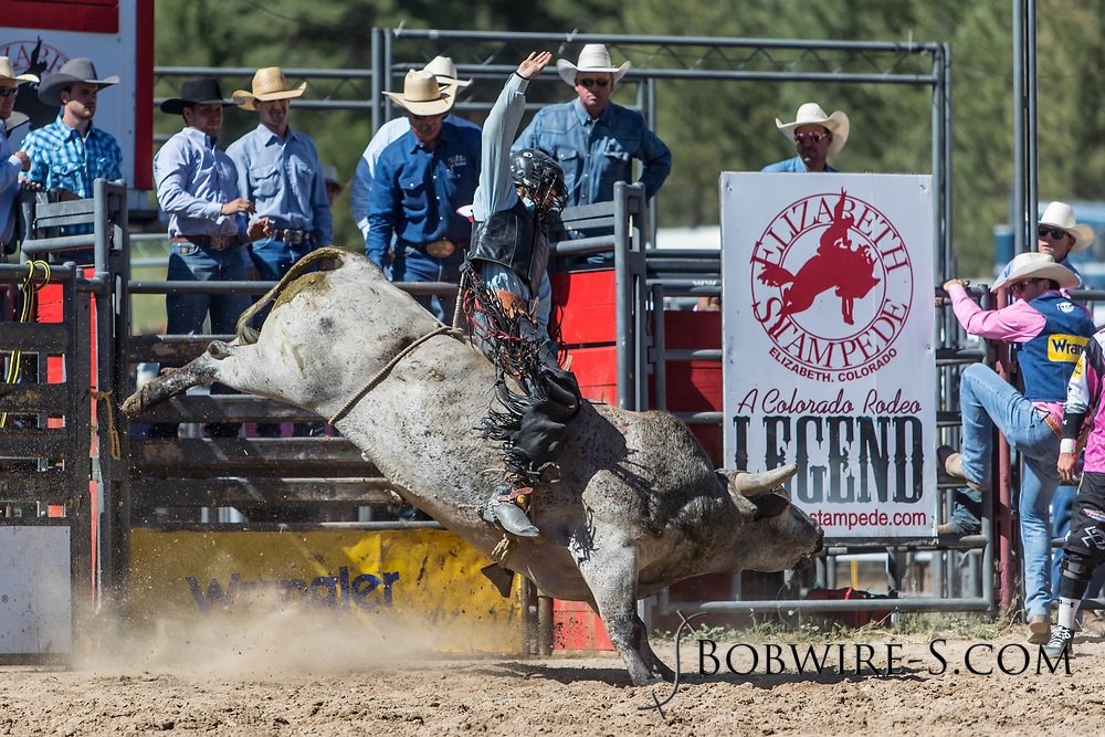 Bull rider Garrett Uptain rides in the first performance of the Elizabeth Stampede on Saturday, June 2, 2018.