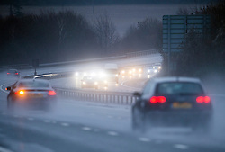© London News Pictures. 30/12/2013 . Farningham, UK.  Traffic deals with difficult driving condition in rain on the M20 at Juntion 1 with the M25 near Farningham, Kent. The UK is braced for more bad weather ager heavy rainfall caused flooding in parts last week. Photo credit : Ben Cawthra/LNP