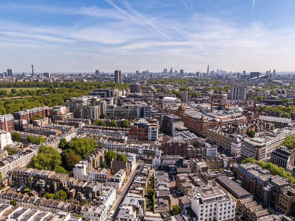 An aerial view of London in England UK with tower blocks and traditional streets looking towards the city of London