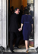 © under license to London News Pictures. 11/05/10. David Cameron and his wife Samantha enter Number 10 Downing Street after he became British Prime Minister. British Prime Minister Gordon Brown has resigned his position and David Cameron has become the new British Prime Minister on May 11, 2010. The Conservative and Liberal Democrats are to form a coalition government after five days of negotiation. Photo credit should read Stephen Simpson/LNP