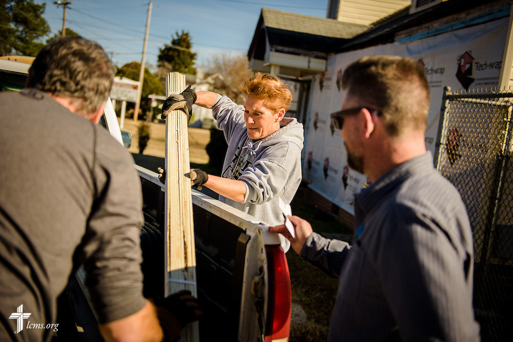 Liz Garlington joins the Rev. Wayne Puls (left), senior pastor, and the Rev. Lew Upchurch, associate pastor at Hope Lutheran Church, Wake Forest, N.C., as they repair Nanny's Korner Care Center on Thursday, Jan. 19, 2017, in Lumberton, N.C. The center was damaged in October from flooding related to Hurricane Matthew. LCMS Communications/Erik M. Lunsford