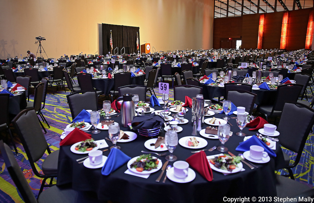 DES MOINES, IA - OCTOBER 25, 2013: Tables are set for the Iowa GOP Ronald Reagan Dinner at the Iowa Events Center - Community Choice Credit Union Convention Center in Des Moines, Iowa. Later in the evening there will be a keynote address by Senator Ted Cruz, Republican of Texas.