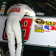 Sprint Cup Series driver Dale Earnhardt Jr. (88) checks over his car in the garage at the Daytona International Speedway on February 18, 2011 in Daytona Beach, Florida. (AP Photo/Alex Menendez)