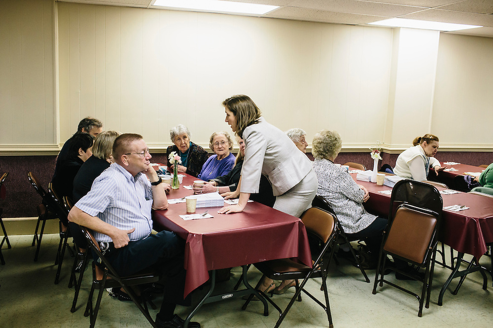West Virginia Secretary of State Natalie Tennant talks with guests, including Frank Mcghee, left, at Romney First United Methodist Church in Romney, W.V. during a Lenten Luncheon on Wednesday, April 16, 2014. Tennant is running for a US Senate seat in West Virginia against Republican Rep. Shelley Moore Capito.