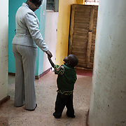 The Stars Foundation visiting Childline Kenya in Nairobi. ..At one of Childline Kenya's referral partners. ..This little boy has just arrived from court after he was found in the street by police. The partner will take care of him until it has been established what his story is, where his parents are, if any, and if he can be returned to them. He is now being shown his bed and around the home...The help line number is 116, the first 3-digit only helpline number in Africa.