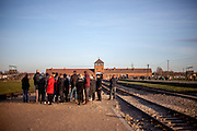 Visitors at the Auschwitz Birkenau Nazi concentration camp. It is estimated that between 1.1 and 1.5 million Jews, Poles, Roma and others were killed in Auschwitz during the Holocaust in between 1940-1945.