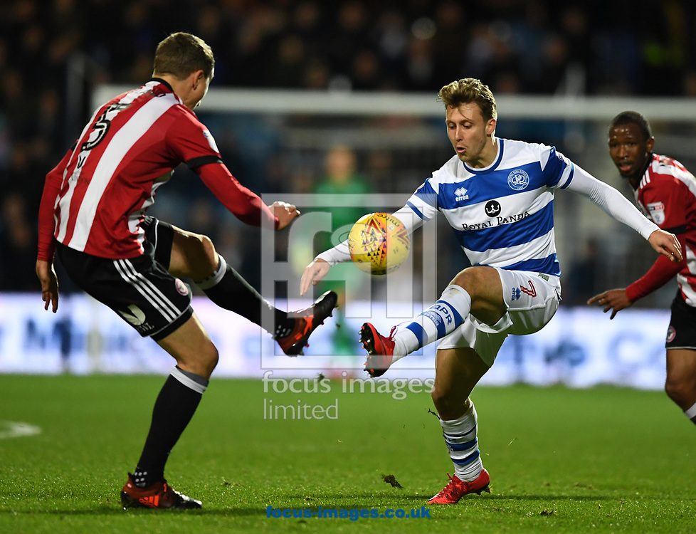 Luke Freeman of Queens Park Rangers and Andreas Bjelland of Brentford battle for the ball during the Sky Bet Championship match at the Loftus Road Stadium, London<br /> Picture by Simon Dael/Focus Images Ltd 07866 555979<br /> 27/11/2017
