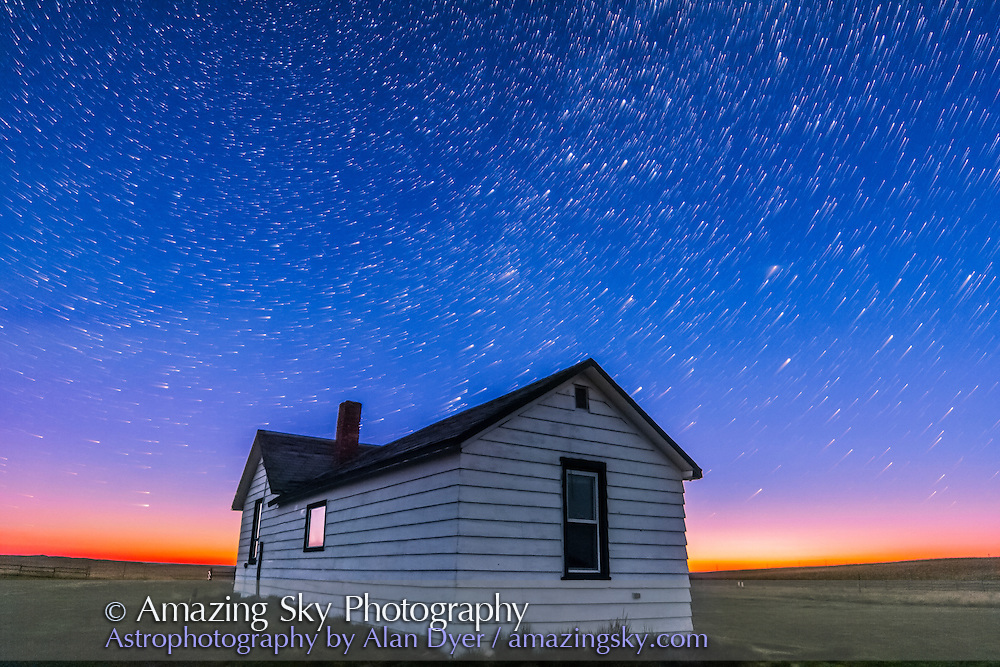 Circumpolar star trails at dawn over the historic Butala homestead at the Old Man on His Back Prairie and Heritage Conservation Area in southwest Saskatchewan, taken May 2015. This is a stack of 70 frames from a larger time-lapse sequence, from the end of the sequence in the dawn twilight. Each exposure is 40 seconds with the 14mm lens at f/2.8 and Canon 60Da at ISO 1600. Stacked with Advanced Stacker Actions. The foreground comes from a stack of 8 of the final exposures, mean combined, to smooth noise.