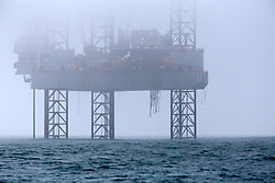 UK ENGLAND POOLE 22FEB19 - A jack-up drill rig stands positioned four nautical miles off the Dorest coast in foggy weather. The Ensco 72 rig is chartered by Corallian to drill one appraisal well in the Wessex Basin.