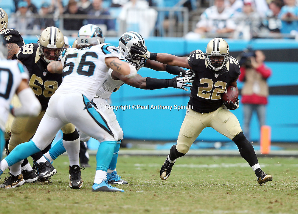 New Orleans Saints running back Mark Ingram (22) straight arms a defender while being chased by Carolina Panthers middle linebacker A.J. Klein (56) during the 2015 NFL week 3 regular season football game against the Carolina Panthers on Sunday, Sept. 27, 2015 in Charlotte, N.C. The Panthers won the game 27-22. (©Paul Anthony Spinelli)