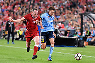 May 24, 2017: Sydney FC George Blackwood (19) and Liverpool FC player Jamie Carragher (4) fight for the ball at the soccer match, between English Premiere League team Liverpool FC and Sydney FC, played at ANZ Stadium in Sydney, NSW Australia.