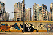 Death's head and new highrise apartment buildings.