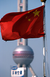 CHINA SHANGHAI MAY99 - The red Chinese communist flag flies in front of the Pearl TV Tower, China's newest symbol for modernity. ..jre/Photo by Jiri Rezac..© Jiri Rezac 1999..Contact: +44 (0) 7050 110 417.Mobile:  +44 (0) 7801 337 683.Office:  +44 (0) 20 8968 9635..Email:   jiri@jirirezac.com.Web:    www.jirirezac.com..© All images Jiri Rezac 1999 - All rights reserved.