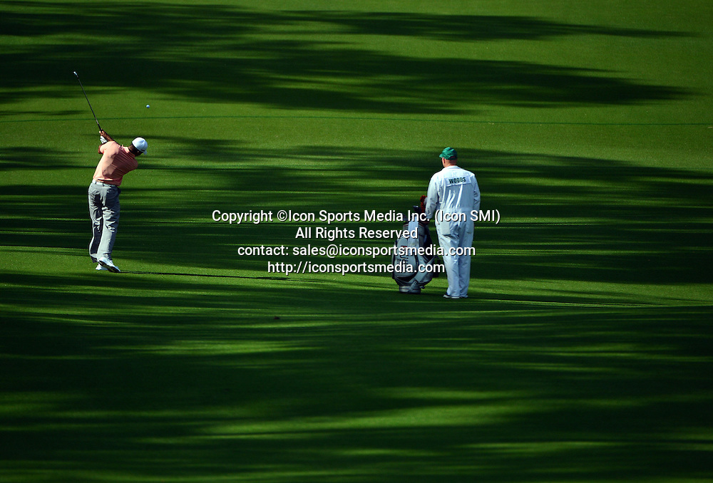 April 9, 2013 - Augusta, Georgia, U.S. - TIGER WOODS hits a shot on the eighth fairway during the second practice round for the 2013 Masters Tournament at Augusta National Golf Club on Tuesday