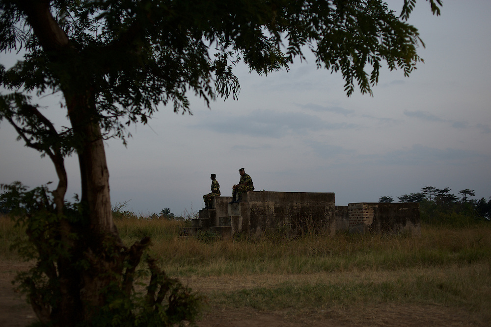 Burundian military men take guard of take guard at a field in Musaga neighbourhood, in Bujumbura, where tents have been settled to be used as a polling station for the upcoming parliamentary elections, June 28th, 2015.