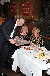 Left to right, NEIL DUDGEON, JOYCE CLUTTEROOK and DONNA STATHERS at One Night Only at The Ivy held at The Ivy, 1-5 West Street, London on 2nd December 2012.