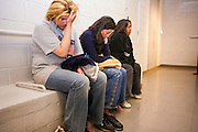 02 MARCH 2006 - Undocumented immigrants who were apprehended by the Maricopa County Sherrif's Dept. wait to be processed in the Madison Street Jail Thursday night. Fiftyfour immigrants were apprehended by MCSO deputies. PHOTO BY JACK KURTZ