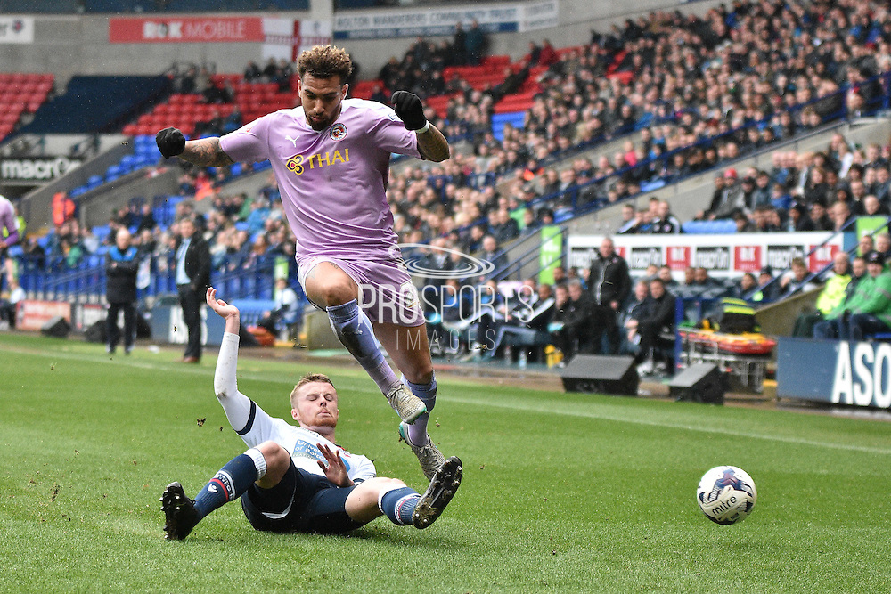 Reading Midfielder, Daniel Williams is tackled during the Sky Bet Championship match between Bolton Wanderers and Reading at the Macron Stadium, Bolton, England on 2 April 2016. Photo by Mark Pollitt.