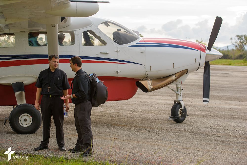 The Rev. Ted Krey, regional director of Latin America Missions for the LCMS, talks with the Rev. Ross Johnson, director of LCMS Disaster Response, at a small airstrip on Tuesday, Oct. 11, 2016, near Les Cayes, Haiti. LCMS Communications/Erik M. Lunsford