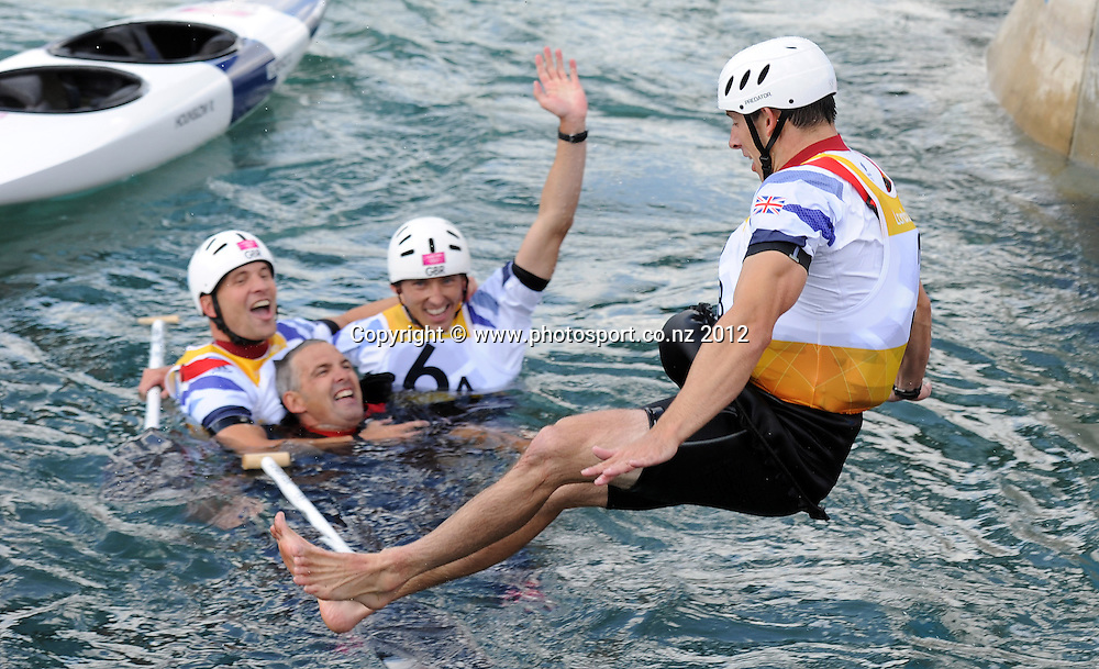 Gold medal winner Etienne Stott jumps in the water to congratulate his GB silver medal winning team mates at the conclusion of the Men's C2 Canoe Slalom at the Lee Valley Whitewater Centre, London, United Kingdom. Thursday 2 August 2012. Photo: Andrew Cornaga/Photosport.co.nz
