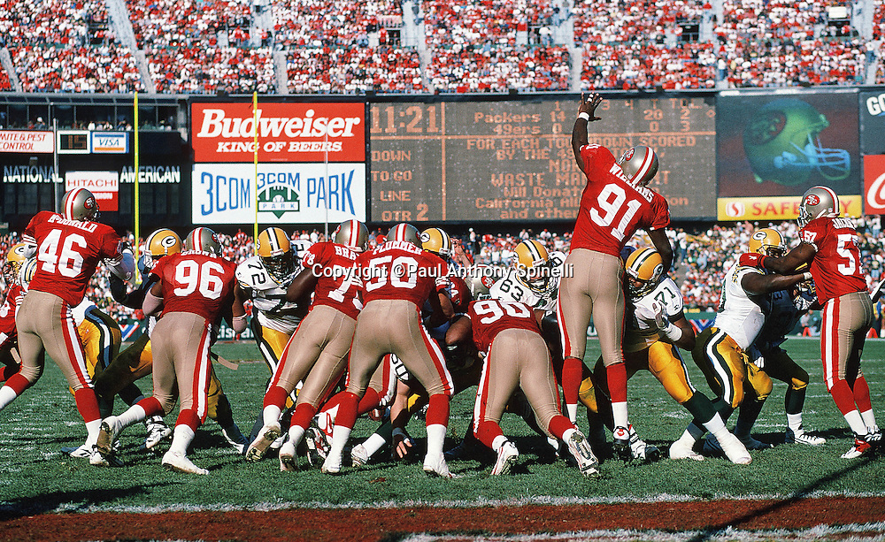 San Francisco 49ers defensive lineman Alfred Williams (91) leaps as he tries to block a kick during the NFL NFC Divisional Playoff football game against the Green Bay Packers on Jan. 6, 1996 in San Francisco. The Packers won the game 27-17. (©Paul Anthony Spinelli)