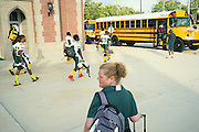 "BIRMINGHAM, AL – SEPTEMBER 11, 2015: Sonya Whitaker (center) waits for the Woodlawn High School football team to board the bus before joining the students. ""I tray to stay back and let him come to me if he gets in trouble. I'm diabetic too."" As a type 1 diabetic, Quintarius Monroe requires frequent blood sugar testing and supervision when self-administering insulin. When care from qualified personnel at his school in Center Point became unavailable, Monroe was forced to transfer several miles away from his locally zoned school to attend Woodlawn High School. The Americans with Disabilities Act requires schools to provide ""reasonable accommodation"" for students with medical conditions, but given that most schools no longer retain school nurses, many schools are failing to provide adequate care for their students.<br />