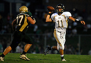 11 SEPT. 2009 -- ST. LOUIS -- Oakville High School quarterback Joe Plassmeyer (11, CQ) looks to pass while under pressure from Lindbergh's Tom Million (77, CQ) Friday, Sept. 11, 2009. Lindbergh led Oakville 14-0 at halftime on a pair of touchdowns by running back Eric Schwartz. Photo © copyright 2009 by Sid Hastings.