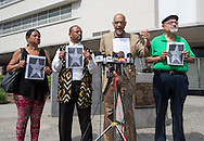 Members of a coalition of black civil-rights advocates hold pictures with a star of Bill Cosby during a news conference on July 9, 2015 in Los Angeles, California. The group calls onto the Hollywood Chamber of Commerce President Leron Gubler to remove Bill Cosby's star on the Hollywood Walk of Fame.(Photo by Ringo Chiu/PHOTOFORMULA.com)