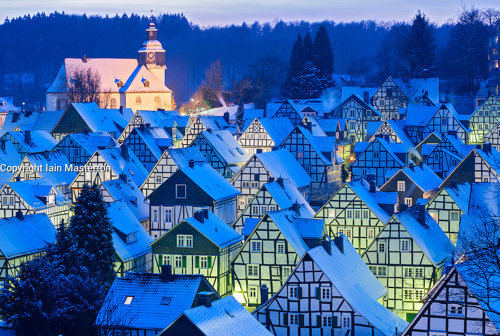 evening winter view of snow covered old houses in Freudenberg Germany