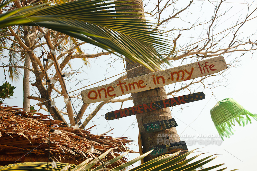 Exuberant sign decorates a tropical bar in Koh Lanta Thailand