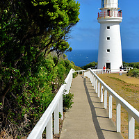 """Cape Otway Lighthouse on Great Ocean Road, Australia<br /> The main attraction on Cape Otway is this lighthouse, the oldest in mainland Australia. It was placed on top of an isolate, 295 foot coastal cliff in 1848. Its mission was to reduce the number of ships that sunk while threading """"The Eye of the Needle."""" Despite the Beacon of Hope's powerful Fresnel lens, there were six more shipwrecks by the end of the 19th century. You can also visit the Head Lightkeeper's Cottage and then have a snack of scones with coffee or tea at the former Assistant Keepers Quarters built in 1858."""