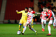 Tommy Rowe of Doncaster Rovers challenges Alex Jakubiak of Bristol Rovers during the EFL Sky Bet League 1 match between Doncaster Rovers and Bristol Rovers at the Keepmoat Stadium, Doncaster, England on 26 March 2019.