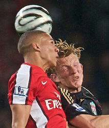 LONDON, ENGLAND - Wednesday, October 28, 2009: Liverpool's Dirk Kuyt and Arsenal's Kieran Gibbs during the League Cup 4th Round match at Emirates Stadium. (Photo by David Rawcliffe/Propaganda)