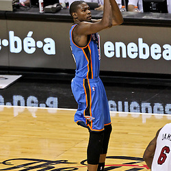 Jun 21, 2012; Miami, FL, USA; Oklahoma City Thunder small forward Kevin Durant (35) shoots against the Miami Heat during the third quarter in game five in the 2012 NBA Finals at the American Airlines Arena. Mandatory Credit: Derick E. Hingle-US PRESSWIRE