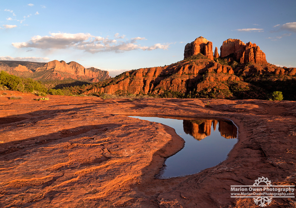 Cathedral Rock in Sedona, Arizona, reflects in a pool.