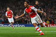 Alexis Sanchez of Arsenal celebrates scoring the opening goal against Besiktas J.K. during the UEFA Champions League match at the Emirates Stadium, London<br /> Picture by David Horn/Focus Images Ltd +44 7545 970036<br /> 27/08/2014