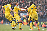 Leeds United Defender, Souleymane Bamba is mobbed by team mates after his goal during the Sky Bet Championship match between Blackburn Rovers and Leeds United at Ewood Park, Blackburn, England on 12 March 2016. Photo by Mark Pollitt.