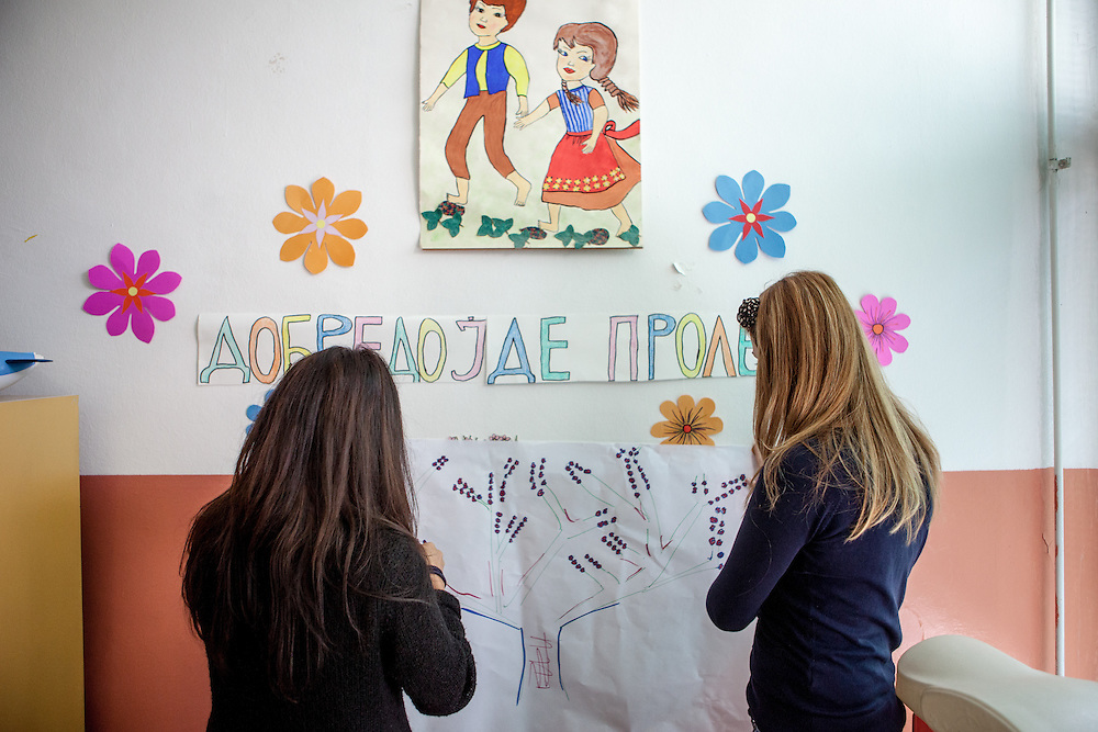 Romina Kajtazova (left) working as a paralegal for NGO Kham is preparing her workshop related to Roma health issues in a kindergarden located in the city of Vinica in Macedonia during the European Immunization Week. Almost all attending women are from the local Roma community.