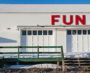 Shuttered amusement park arcade building in winter