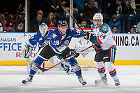 KELOWNA, CANADA - DECEMBER 30: Marsel Ibragimov #28 of the Victoria Royals checks Kyle Topping #24 of the Kelowna Rockets during first period on December 30, 2016 at Prospera Place in Kelowna, British Columbia, Canada.  (Photo by Marissa Baecker/Shoot the Breeze)  *** Local Caption ***