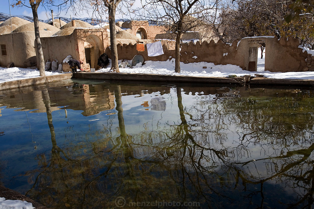 A pool of icy water from a qanat that serves  Ghayoumabad village, near the highway between Yazd and Esfahan in the foothills of the Zagros Mountains of central Iran. Qanats are underground water distribution systems developed in ancient Persia and designed to provide water over long distances, especially useful in hot, arid climates.