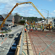"BATH, Maine -- Repaving and Construction efforts on the Bath Viaduct Overpass are at least a week ahead of schedule according to Peter Brown, State of Maine Project Resident. The originally scheduled date of completion was to be May 23. .""The driving surface is actually cement,"" Brown said on Tuesday, May 1.""We're not going to add additional pavement on top of what's here.""  While the exact completion date is a function of the next few weeks' weather, the Freeport-based construction crew is nearly completed with finishing the cement surface of the last section of bridge. The cement will take about a week to cure, and lines will have to be painted. Also, because they chose to use cement instead of pavement, the project will come in both ahead of schedule and on budget -- including a speed bonus of $10,000 per day ahead of schedule for the work crew. Photo by Roger S. Duncan."