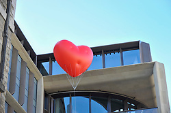 "© Licensed to London News Pictures. 15/02/2018. LONDON, UK.  London, UK.  15 February 2018.  A giant chubby heart balloon is seen outside Bloomberg's HQ in Queen Victoria Street during ""Chubby Hearts Over London"", a design project conceived by Anya Hindmarch.  Supported by the Mayor of London, the British Fashion Council and the City of Westminster giant chubby heart balloons will be suspended over (and sometimes squashed within) London landmarks as a declaration of love to the city starting on Valentine's Day and continuing throughout London Fashion Week.  Photo credit: Stephen Chung/LNP"