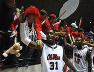 "Mississippi's Murphy Holloway (31) and Mississippi's Maurice Aniefiok (12) celebrate with the student section following the game against Mississippi State at the C.M. ""Tad"" Smith Coliseum in Oxford, Miss. on Wednesday, January 18, 2012. Mississippi won 75-68. (AP Photo/Oxford Eagle, Bruce Newman)."