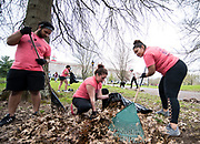 Jorge Nunez, Alexis Reed, and Briana  rake and pick up leaves at the front entry of the Dairy Arts Barn during Athens Beautification Day on Sunday, April 22th 2018.