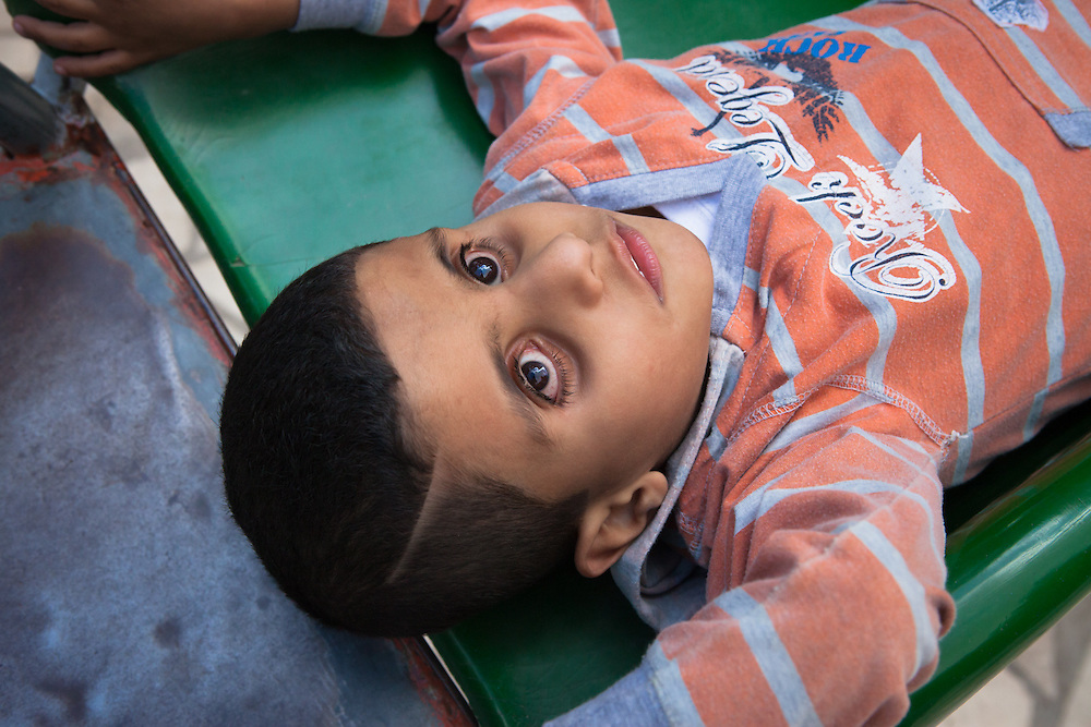 Mourhaf is six years old. He was born both deaf and blind, although he can distinguish between pitch blackness and very bright lights. He likes to jump on trampolines, to lay on the ground and to stare at the sun. Although he enjoys to discover the world around him, he doesn't like school and is often giving his patient teachers a hard time. During weekdays, he lives at the Holy Land Institute for the Deaf, a school for deaf and deaf-blind children in the city of Salt, Jordan.<br />