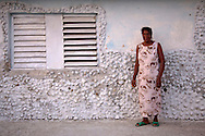 Woman and house in Niquero, Granma, Cuba.