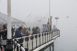 © Licensed to London News Pictures. 11/03/2017. Brighton, UK. A thick cloud of fog hangs over Brighton and Hove beach hiding most of the Brighton Palace Pier from view. Photo credit: Hugo Michiels/LNP