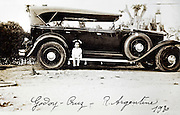little girl posing with car  Argentine 1930
