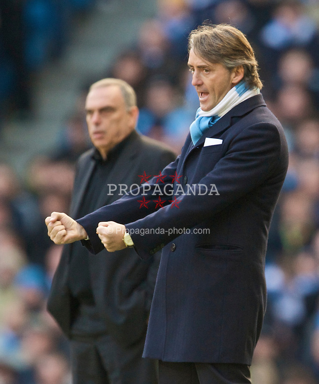 MANCHESTER, ENGLAND - Sunday, January 31, 2010: Manchester City's manager Roberto Mancini celebrates as his side beat Avram Grant's Portsmouth during the Premiership match at the City of Manchester Stadium. (Photo by David Rawcliffe/Propaganda)